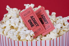 Popcorn and tickets. Popcorn with two admit tickets in a popcorn bag Stock Photo