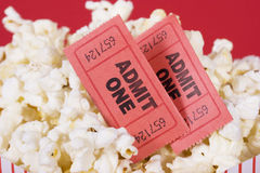 Popcorn and tickets. Popcorn with two admit tickets in a popcorn bag Stock Photography