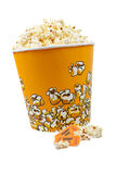 Popcorn and tickets. Popcorn bucket with two tickets on white background Stock Image