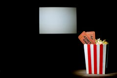 Popcorn with tickets on a white background screen Royalty Free Stock Photos