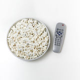 Popcorn and tv. Bowl of popcorn with remote control, tv addict concept Stock Images