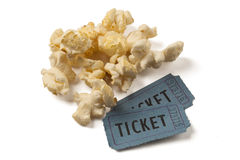 Popcorn and two movie tickets. Close up of two tickets stubs in a box of popcorn. Clipping path included Royalty Free Stock Photos