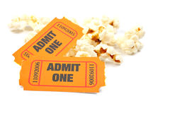 Popcorn and two tickets. On white background with soft shadow. Shallow DOF Royalty Free Stock Images