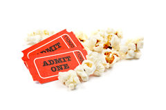Popcorn and two tickets. On white background with soft shadow. Shallow DOF Royalty Free Stock Image