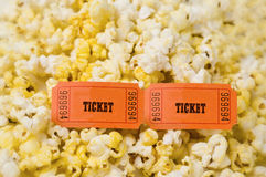 Popcorn and two tickets. Close up shot of popcorn with two entertainment tickets Royalty Free Stock Photo