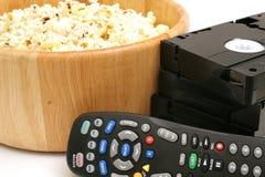 Popcorn u. Video mit Fernsteuerungsvhs Lizenzfreie Stockbilder