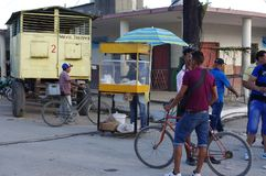 Popcorn vendor and movable beer bar. In the background on the streets of Guayos, a small Cuban town setting up for an evening festival Royalty Free Stock Photos