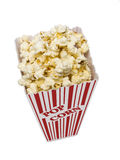 Popcorn Vertical Shot On White Background. Great vertical shot of delicious and buttery popcorn in a small tub and isolated on a white background Royalty Free Stock Photography
