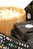 Popcorn & video w/remote control vhs vertical. Shot of popcorn & video w/remote control vhs vertical Stock Photography