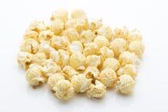 Popcorn  on the white background. Royalty Free Stock Photos