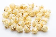Popcorn  on the white background. Stock Photos