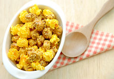 Popcorn in white bowl over wooden background Royalty Free Stock Image