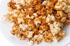 Popcorn on a white plate Royalty Free Stock Photos