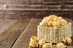 Popcorn in the Wicker baskets on the table woodbackground Royalty Free Stock Images