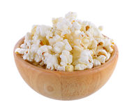 Popcorn in wood bowl isolated Stock Image
