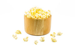 Popcorn in a wooden bowl on isolated background Stock Images