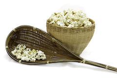 Popcorn in a wooden bucket on white background Royalty Free Stock Photography