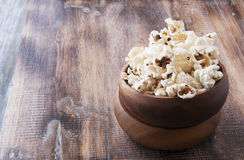 Popcorn in a wooden plate on the background Stock Image