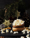 Popcorn in a wooden plate on the background of Christmas Royalty Free Stock Images