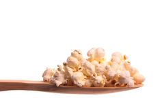 Popcorn on a wooden spoon Stock Image
