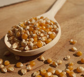 Popcorn. On a wooden spoon, on a cut board Royalty Free Stock Photos