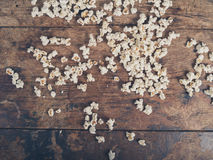 Popcorn on wooden surface Royalty Free Stock Images