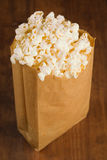 Popcorn on wooden table Royalty Free Stock Photos