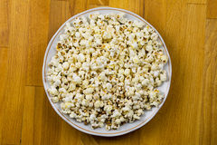 Popcorn on a wooden table background bar counter light snack at the party Royalty Free Stock Photo
