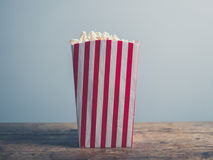 Popcorn on wooden table Royalty Free Stock Photo