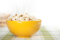 Popcorn in a yellow bowl Royalty Free Stock Photos