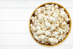 Popcorn in Yellow Bowl over white Timber Top View Royalty Free Stock Images
