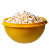 Popcorn in a yellow bowl on white background Royalty Free Stock Images