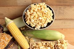 Popcorn and yellow dry corn grain with fresh corn. Stock Images