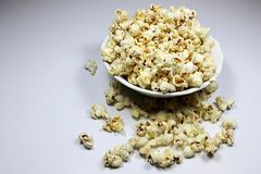 Popcorns. Corn of a variety with hard kernels that swell up and burst open with a pop when heated Stock Images