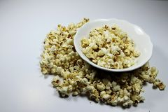 Popcorns. Corn of a variety with hard kernels that swell up and burst open with a pop when heated Stock Photography