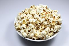 Popcorns. Corn of a variety with hard kernels that swell up and burst open with a pop when heated Royalty Free Stock Photography