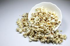 Popcorns. Corn of a variety with hard kernels that swell up and burst open with a pop when heated Stock Photo