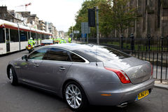 Pope Benedict XVI driven in Jaguar XJL, Edinburgh. Pope Benedict XVI being driven from Edinburgh Airport to Holyrood Palace in Jaguar XJL. Photo taken on Stock Image