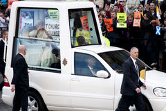 Pope Benedict XVI and protesters. Pope Benedict XVI visiting Edinburgh, Scotland. Protesters in the background stock image