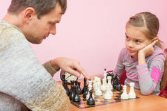Pope explains daughter tactics of game of chess. Pope explains daughter tactics of the game of chess Royalty Free Stock Photo