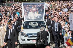 Pope Francis I blesses the faithful. Blaj, Romania - June 2, 2019: Pope Francis arriving for Mass with pope-mobile and blesses the faithful royalty free stock photos