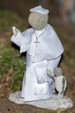 Pope francis small stone statue Stock Images