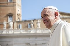 Pope Francis smiling to faithful as he arrives for his weekly general audience stock photo