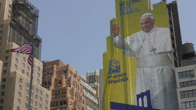 Pope Francis visit USA 2015. New York, USA - September 3, 2015: Giant mural of Pope Francis greets locals and tourists in New York City on September 3, 3015