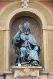 Pope Gregory XIII statue on King Enzo palace at Bologna main square Stock Image