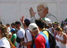 Pope John Paul II graffiti waves at crowd in a protests in the streets of Caracas Venezuela against the government of Nicolas Madu Stock Image