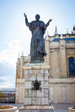 Pope John Paul II statue and Cathedral Almudena on a spring day Royalty Free Stock Photos
