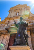 Pope John Paul II Statue. Statue of Pope John Paul II at the entrance of the Gozo Cathedral with artistic sun flares Stock Images