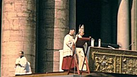 Pope Saint Paul VI blessing believers. VATICAN CITY, ROME, ITALY - CIRCA 1970: old Pope Saint Paul VI blessing the believers during the mass in Saint Peter stock footage