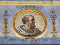 Pope Sylvester II. The icon on the dome with the image of Pope Sylvester II or Silvester II was Pope from 2 April 999 to his death in 1003, basilica of Saint Royalty Free Stock Photography